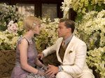 Catherine Martin: The color of Daisy's dress and the look of Gatsby come entirely from the book. Fitzgerald wrote that Gatsby was wearing a cream suit, a silver shirt and a gold tie. Daisy is described as wearing a lavender dress with a row of brass buttons and a tri-corner hat. We kept the lavender but the brass buttons overwhelmed me. So, in her epaulets there are these little brass daisies and also sewn into the moving panels in the bottom of her dress.