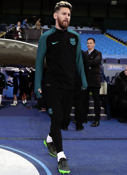 Lionel Messi walks out during a training session ahead of the UEFA Champions League match between Manchester City and Barcelona at the City Football Academy on October 31, 2016 in Manchester, England.