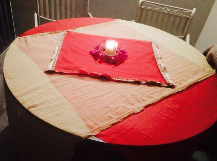 Candle light dinner in home portico #romantic #love #decorated with #colorful clothes on table #flowers  #candle ...