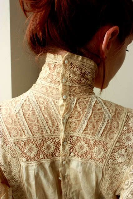 There is something intensely evocative and oddly erotic in the high-necked, button-up the back lace shirt.