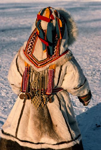 A young Nenets girl in traditional reindeer skin winter clothing. Yamal, Siberia, Russia.