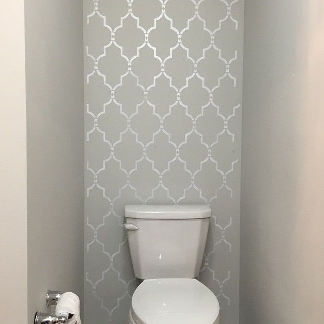 A DIY silver and gray stenciled accent wall in a bathroom using the Marrakech Trellis Stencil from Cutting Edge Stencils. http://www.cuttingedgestencils.com/moroccan-stencil-marrakech.html Photo from yourbeautifulhome_