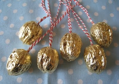 goldene Nuesse - bright gold colored walnut shells with loop for hanging on tree.