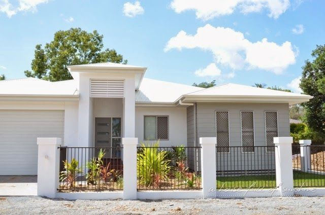 White and grey exterior colour scheme with rendered front fence