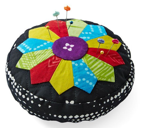 Use a black-and-white batik as a foundation to showcase beautiful and bright  colors. A Dresden Plate block blooms like a flower from the center of this  pincushion.Fabrics are from the Indah Hand-Dyed Batiks collection for  Hoffman California Fabrics [1].   [1] http://hoffmanfabrics.com