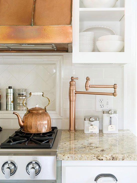 I like the counter color, white cabinets, and copper.
