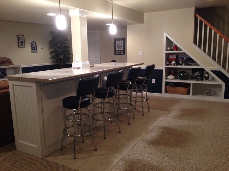 Bar built around center support pole in basement for Built in bar counter