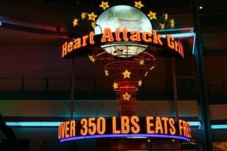TIL of Heart Attack Grill, a Las Vegas restaurant where people over 350 lbs. eat free. 3 people have died while eating there, and the only vegan option on their menu is cigarettes. : todayilearned