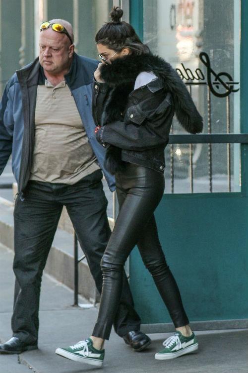 Kendall Jenner wearing Saint Laurent Classic 11 Aviator Sunglasses and Revenge x Storm Vans in Green