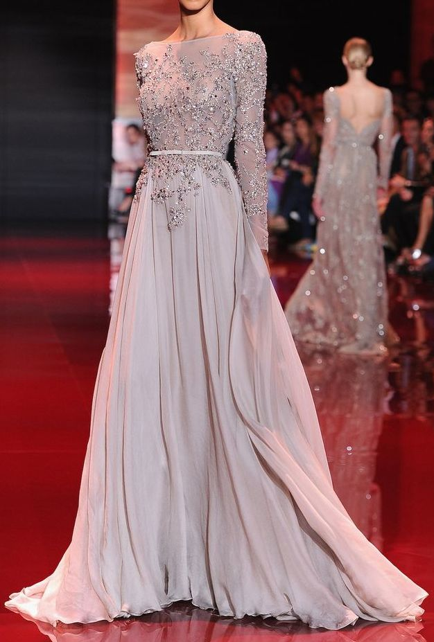 Elie Saab Gown 3/4 length sleeve with an open back, higher waist belt and more structured skirt.