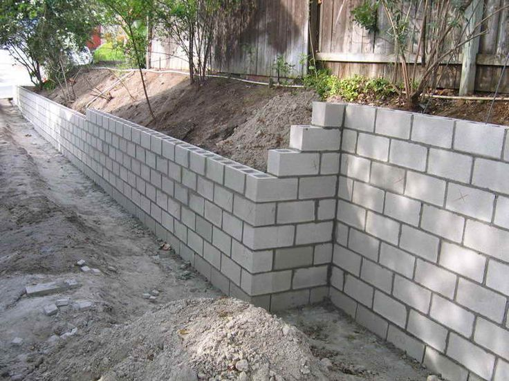 Cinder Block Retaining Wall with the installation