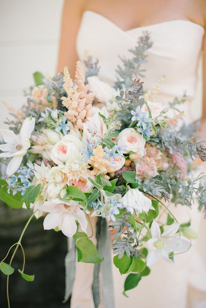 Over the top stunner featuring clematis, roses, tweedia, astilbe, blushing bride, acacia foliage...