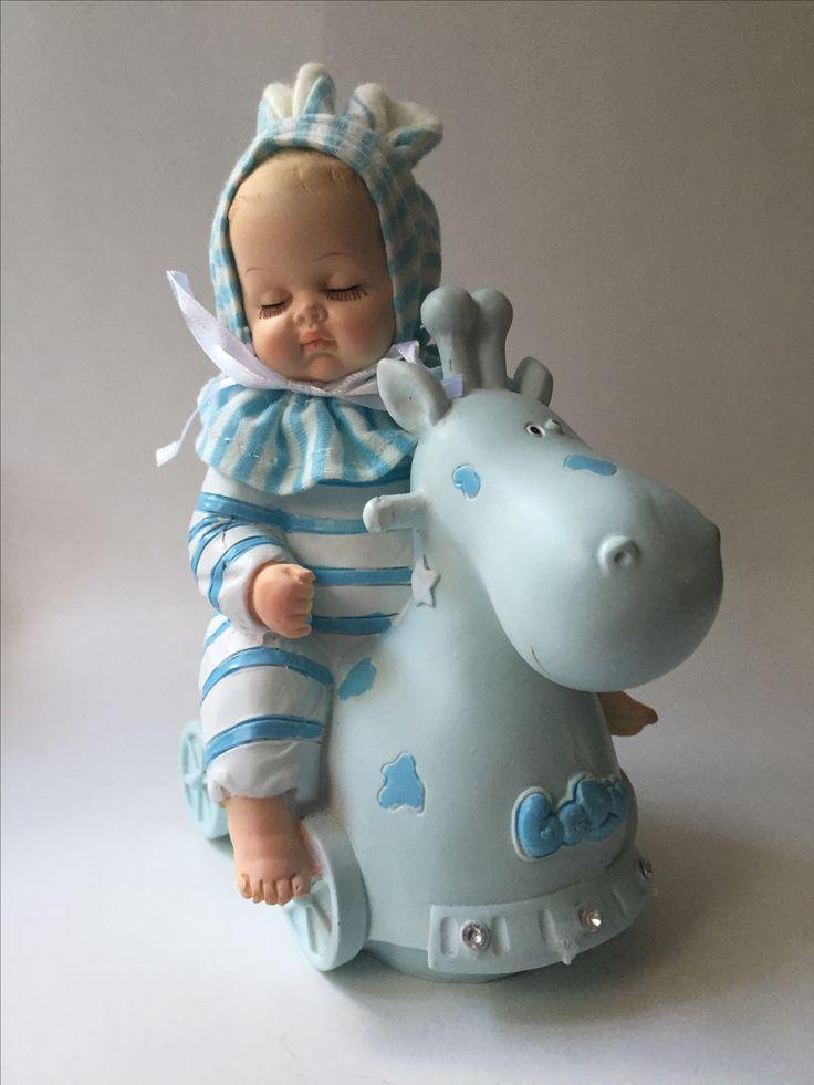 Muziekdoos baby op speelpaard  baby beweegt mee met de muziek