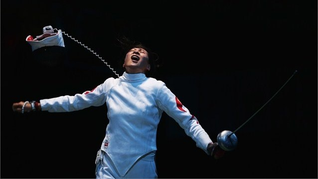 Yujie Sun of China celebrates after beating Anna Sivkova of Russia during the Women's Epee Team Fencing semifinal on Day 8 of the London 2012 Olympic Games at ExCeL