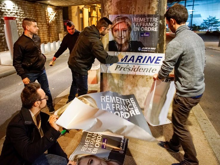 Members of the National Front youths put up posters of Marine Le Pen, French National Front (FN) political party leader and candidate for the French 2017 presidential election, ahead of a 2-day FN political rally to launch the presidential campaign in Lyon, France, February 2, 2017.