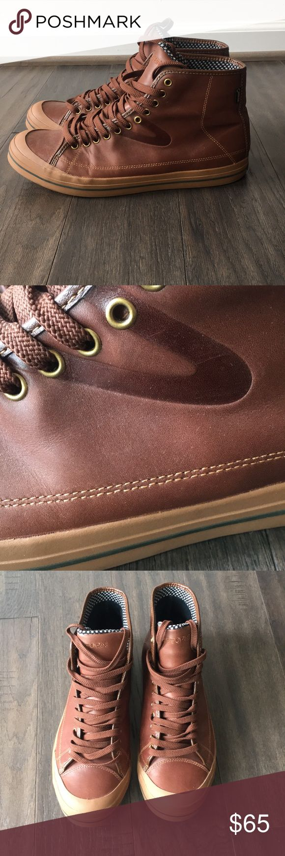 Leather high top Tretorn Mens very gently worn brown leather Tretorn high tops.  Brown laces with brass colored grommet lace ups.  Bubblegum soles.   Clean and classic. Tretorn Shoes Sneakers