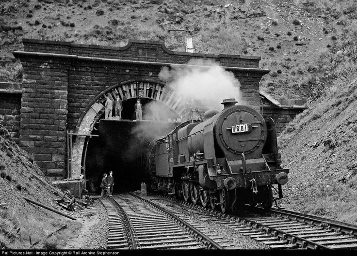 If you are of a nervous disposition please look away now! Former LMS Patriot class three-cylinder 4-6-0 No 45538 Giggleswick leaves the 1894 double double track bore of Standege tunnel with an eastbound extra passenger train in 1951 as a team of builders repair the brick ring around the entrance in pouring rain. Another gem taken by the late Kenneth Field on 6 x 9 fil m (120 size).