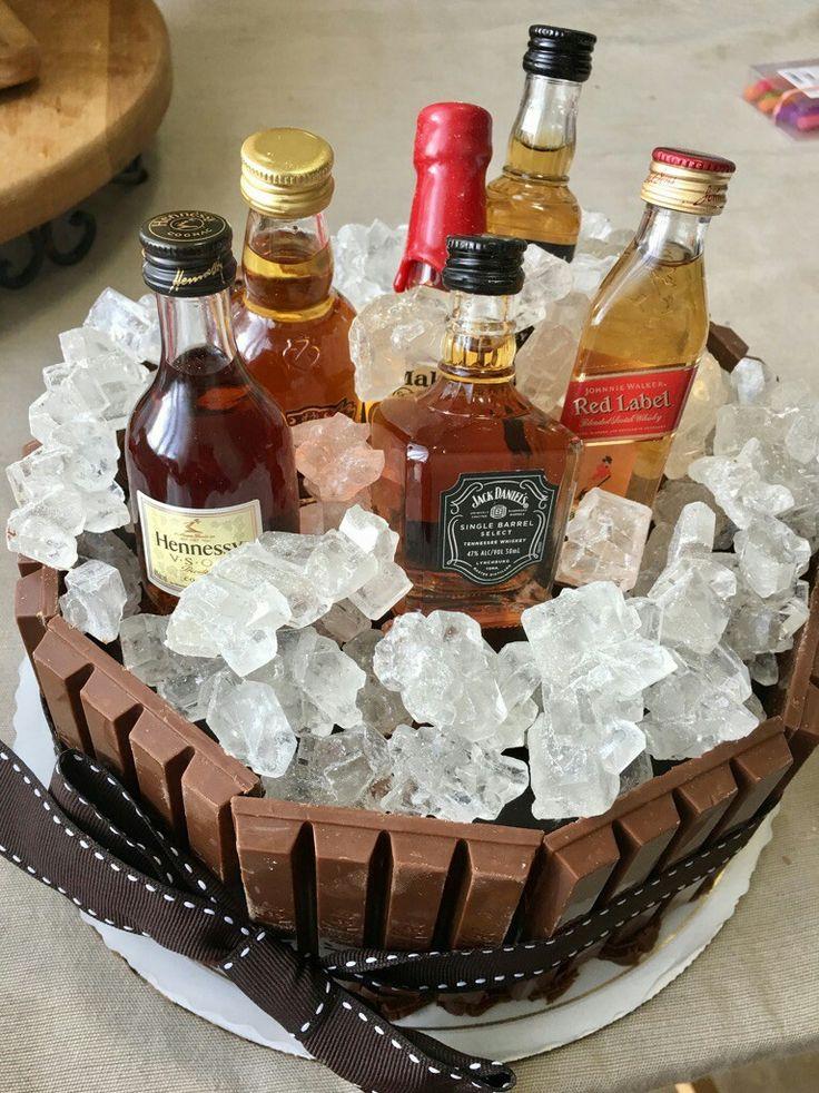 hubby's 40th birthday cake- kitkat, white rock candy and mini liquor bottles