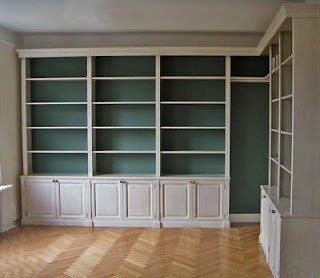 Built-in bookcases with blue/green paint- I love built-ins and the color added makes it more special