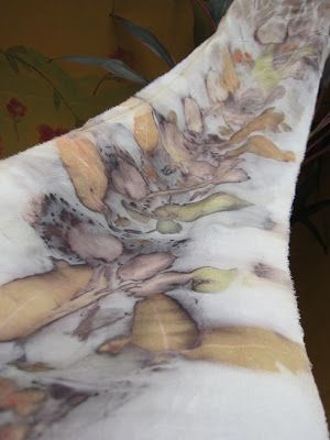 Silk scarf with eco prints of rose petals, rose leaves and eucalyptus leaves