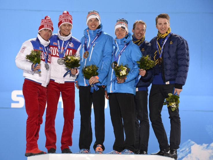 Sochi 2014 Day 14 - Medals Ceremony Silver medalists Maxim Vylegzhanin and Nikita Kriukov of Russia, gold medalists Iivo Niskanen and Sami Jauhojaervi of Finland and bronze medalists Teodor Peterson and Emil Joensson of Sweden celebrate on the podium during the medal ceremony for the Cross Country Men's Team Sprint on day 14 of the Sochi 2014 Winter Olympics at at Medals Plaza