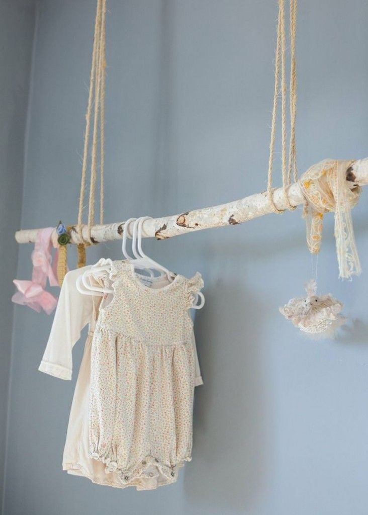 dresses hung from a branch apartment therapy