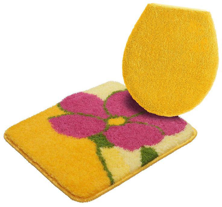 2-tlg. Hänge-WC-Set »Sunny«. Die gelungene Kombination aus harmonischen Tönen im Blumen-Design bringt jede Badematte zum Strahlen. Angenehm hoher Flor mit weichem Griff. Mit umkettelter Außenkante und rutschhemmend beschichtet. Das 2-tlg.Set besteht aus einem WC-Deckelbezug in Normgrößer, einem WC-Vorleger (50/45).   Details:  Floral Gemustert,  Qualität:  Maschinell getuftet, 1,6 kg/m² Gesamtg...