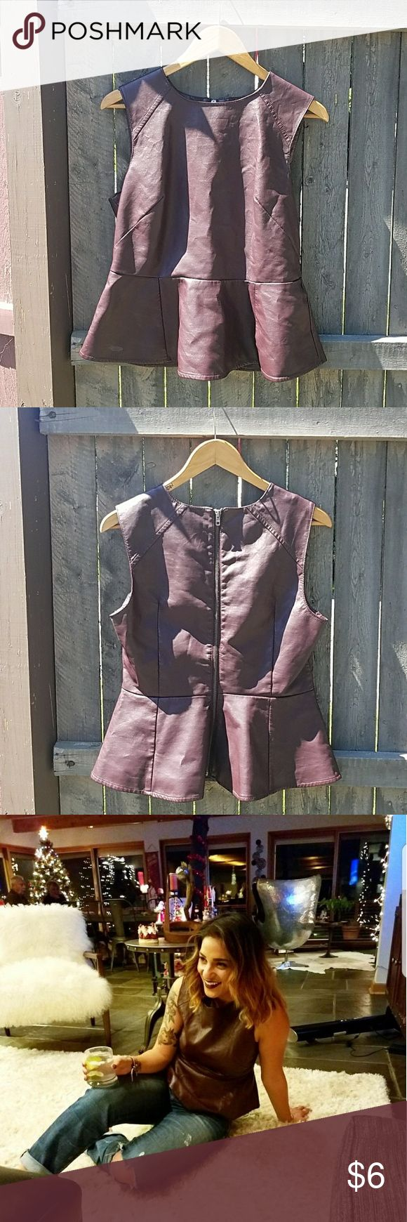 Faux Leather Peplum Top Faux leather peplum top in burgundy. Featuring full exposed zipper down the back and darts for a perfect fit. Wear alone or layer over your favorite tee! mandee Tops