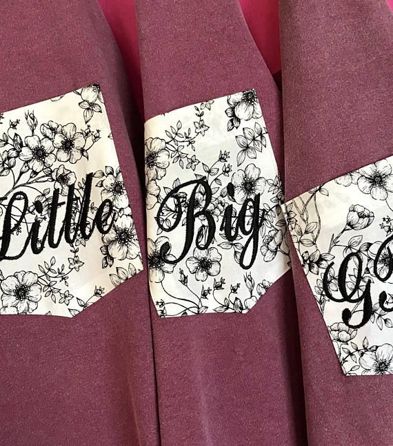 Big Little Sorority Black & White Floral Fabric Pocket Comfort Colors TShirt The Black & White Floral print fabric Pocket looks great on a Berry, Seafoam, Blossom or Pepper Comfort Colors TShirt Sorority Family names are embroidered using Black thread in the Traditional Script font.