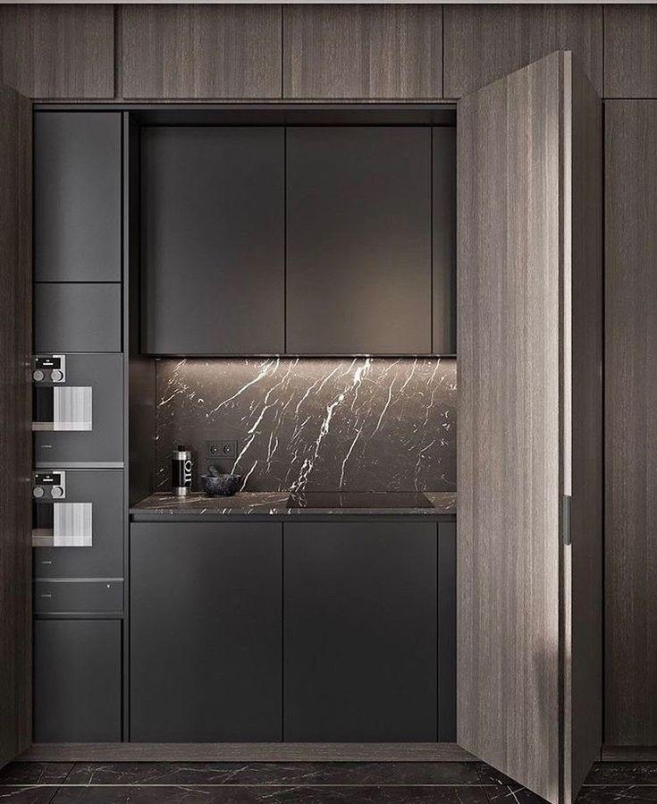 A gorgeously dark kitchen with both sink ovens hidden - Cocinas ocultas ...
