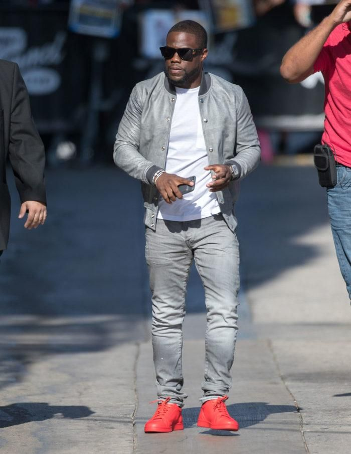 Kevin Hart wearing a grey jacket by John Elliott and a pair of red sneakers  by Saint Laurent. d5ec4bb5e