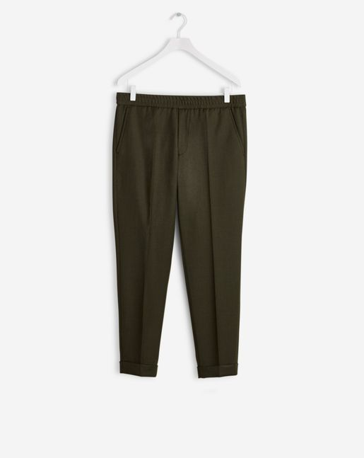 Cropped gabardine slim-fit trousers with a narrow leg. The trousers have a comfortable elasticated waistbandwith a functional fly, two slanted front pockets and two back pockets. Suitable for everyday, this wearable style also features turn-ups. Pressed