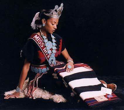 """Miss Navajo Nation 1997-1998, Radmilla Cody """"Millie"""" I am of the Red Bottom People clan. Born for the African Americans. My maternal grandfathers clan is the Mexican clan. My paternal is the African Americans. I am 46th Miss Navajo Nation. I am 21 years old and I grew up in Grand Falls which is about 15 miles East of Leupp. I was a 1993 graduate of Coconino High School in Flagstaff, Arizona."""