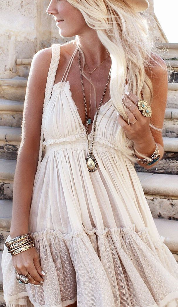 Sexy boho chic gauzy dress with chunky hippie bracelets and layered necklaces.