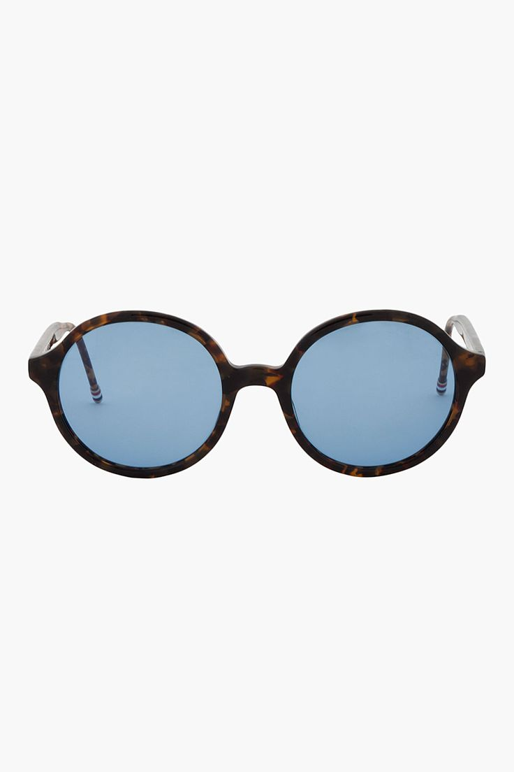 THOM BROWNE //  Black & Brown Tokyo Tortoise Round Sunglasses  31381M013012  Round lens sunglasses in black and brown tortoiseshell pattern. Thin acetate frame with titanium skeleton and tricolor detail at temple tips. Blue lenses with anti-reflective coating. Size: 53 21-148.  Please note that this item cannot be shipped to countries in the European Union.  Frame: acetate/titanium. Made in Japan.  $475 CAD