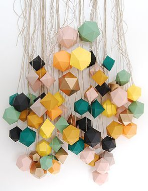 paper mobile made from metallic gold paper cubes - great inspiration for a colour scheme.