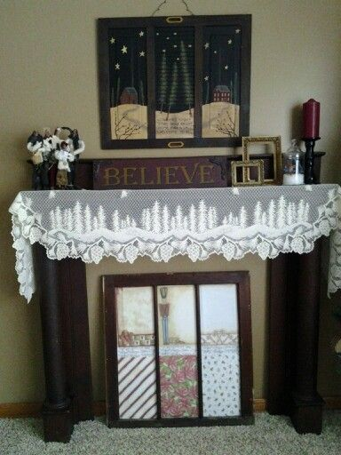 Fake fireplace mantle decorated for Christmas