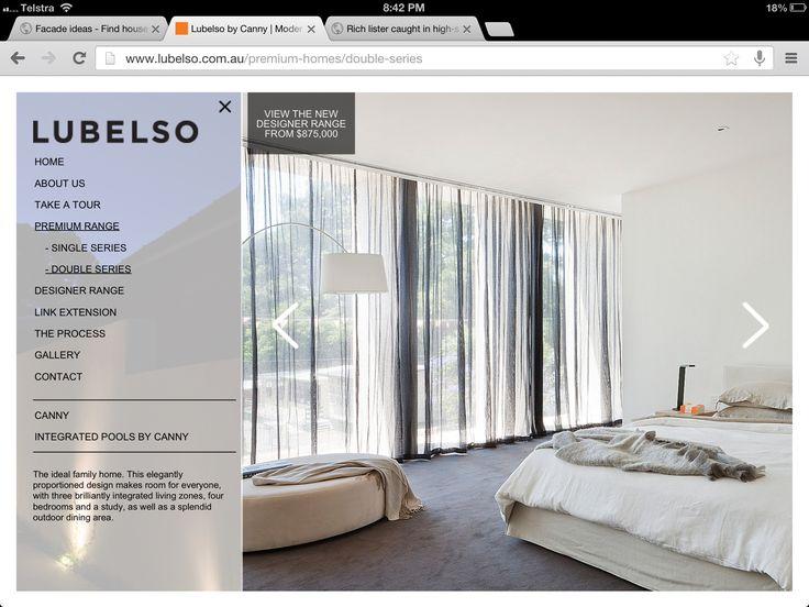 Black curtains, grey carpet, white bedding