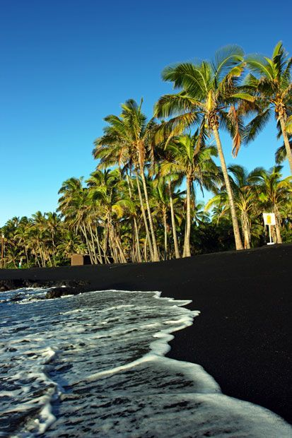 Punaluu Beach, Hawaii  Punaluu Beach is rocky, cold-watered and entirely black. It's basalt sand being the product of ancient volcanic lava cooled by the sea.