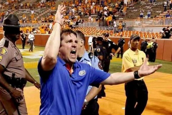 Will Muschamp giving a huge Gator chomp after winning at Tennessee! For insider authority on Football, Football recruiting, and more visit GatorCountry.com