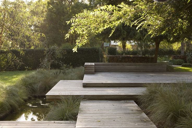 beautful decking that glides straight into a little pool.  Maybe create a raised version with a glass wall?