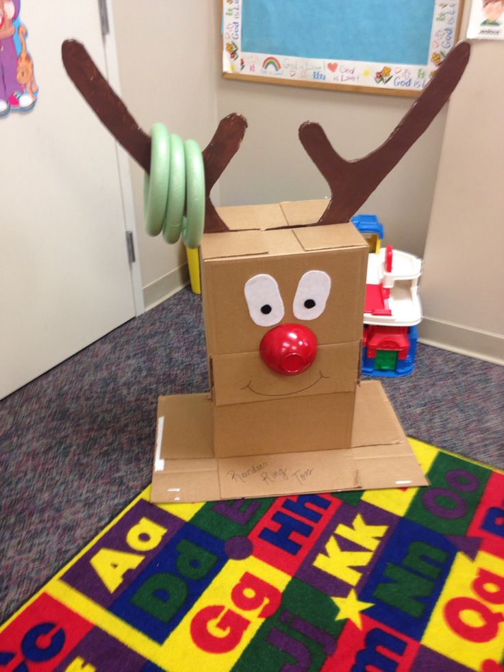Reindeer ring toss I made. Easy party game to make. Cardboard box body, cardboard or foam board antlers, foam rings from dollar store. His nose is a plastic bowl :)
