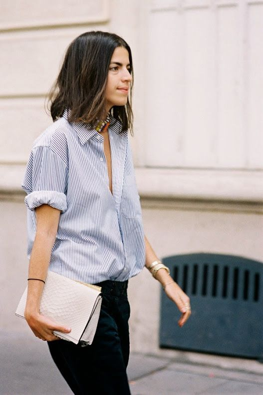 Paris Fashion Week - all right it's not a white shirt. It's how she wears the shirt that caught my eye.