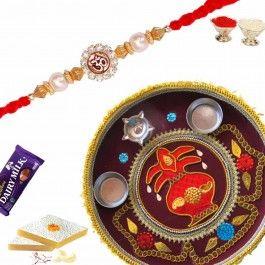 Send #Rakhi #Gifts to dearest brother with Divine Om Rakhi and #Rakshabandhan Shagun Thali from http://www.rakhistoreonline.com/buy-rakhi-with-thali/divine-om-rakhi-with-rakshabandhan-shagun-thali.html