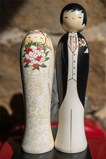 A delightful couple dressed in their ancient finery for their wedding day is artfully created in the kokeshi style by a very talented artisa...