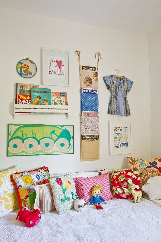 Gorgeous cushions and wall display - lots of pretty stuff in a small space.