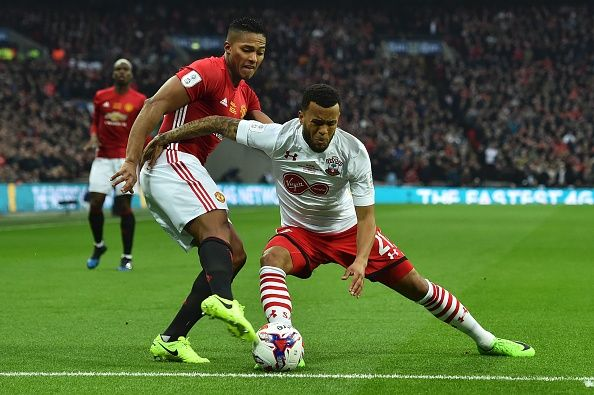 Manchester United's Ecuadorian midfielder Antonio Valencia vies with Southampton's English defender Ryan Bertrand during the English Cup final...
