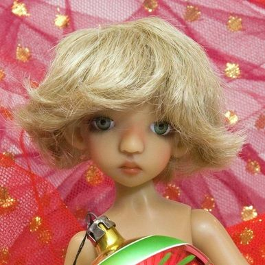 How to make a doll wig with a crochet cap and wefts.