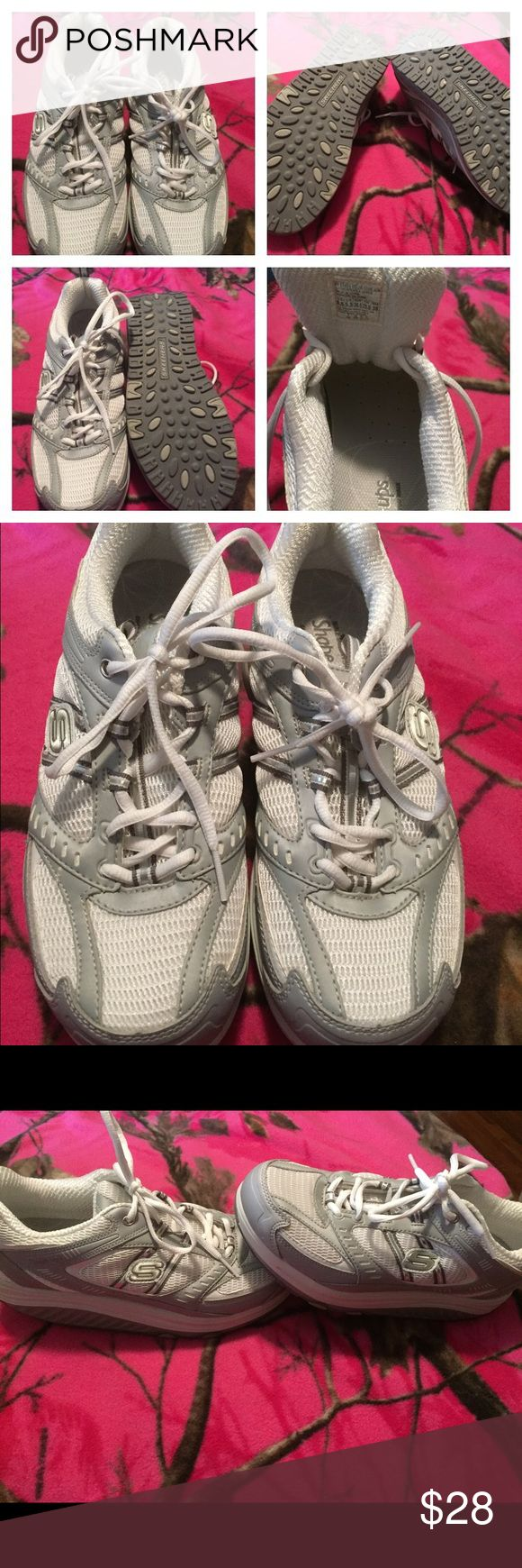 NWOT SIZE 8.5 (8 1/2) Skechers Shape ups NWOT Silver and white Skechers shape ups. These shoes were worn around the house, but did not fit me.  I do not see any flaws on them.  Women's size 8.5 (8 1/2). Skechers Shoes Athletic Shoes