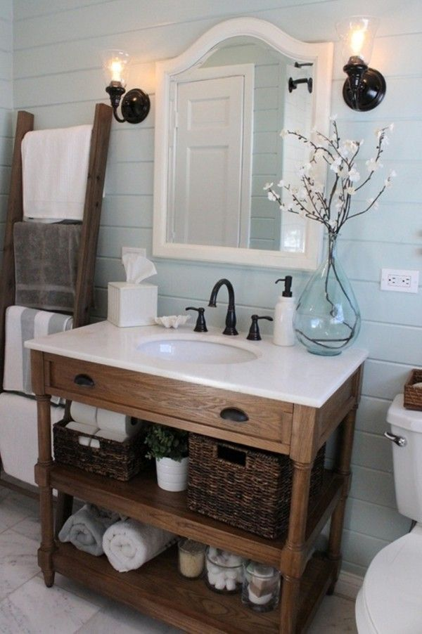 Image of Witching Rustic Bathroom Vanity Ideas Using Solid Walnut Dresser with 2 Tier Shelving Unit for Storing Dark Wicker Basket and Matte Black Drawer Cup Pulls also Glass Shade Wall Lamp with Bathroom Vanity Lights Bathroom Mirrors Brushed Nickel White Traditional Bathroom Vanities Mirror Country Bathroom Decor Ideas